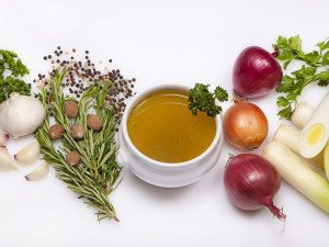 Soup bowl of vegetable stock and ingredients --- Image by © Foodcollection/the food passionates/Corbis